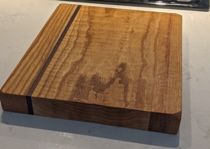 Curly oak cutting board
